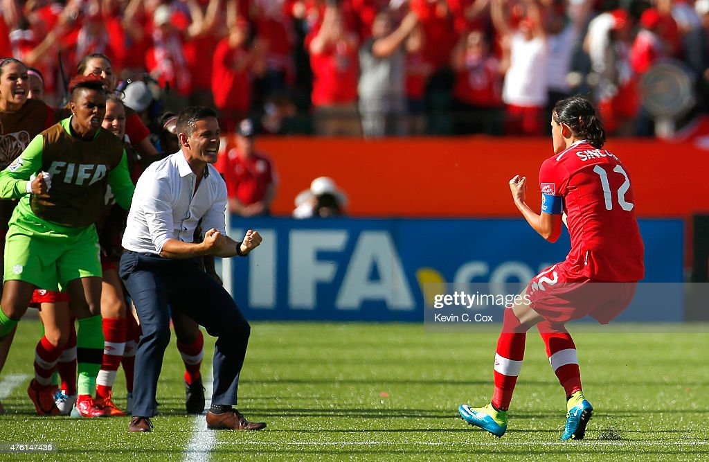 Christine Sinclair #12 of Canada celebrates scoring the go-ahead goal on a penalty kick against China PR as she runs to John Herdman during the FIFA Women's World Cup Canada 2015 Group A match between Canada and China PR at Commonwealth Stadium on June 6, 2015 in Edmonton, Canada.