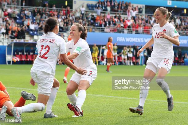 Christine Sinclair of Canada celebrates scoring their first goal with Allysha Chapman and Janine Beckie during the 2019 FIFA Women's World Cup France...