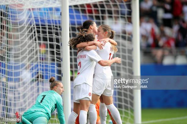 Christine Sinclair of Canada celebrates with Allysha Chapman of Canada and Janine Beckie of Canada after scoring a goal to make it 1-1 during the...