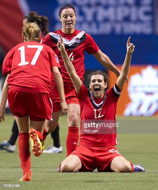 Christine Sinclair of Canada celebrates with teammates Melissa Tancredi and Brittany Timko after defeating Mexico 31 in the semifinals of the 2012...