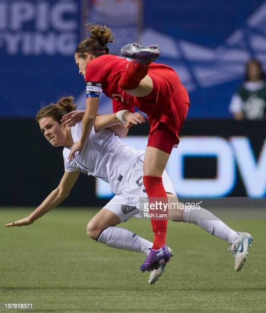 Christine Sinclair of Canada collides with Kelley O'Hara of the United States during second half of championship action of the 2012 CONCACAF Women's...