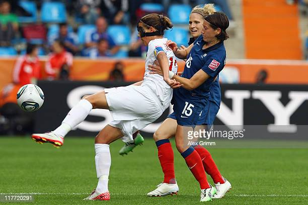 Christine Sinclair of Canada is challenged by Elisa Bussaglia and Laure Lepailleur of France during the FIFA Women's World Cup 2011 Group A match...