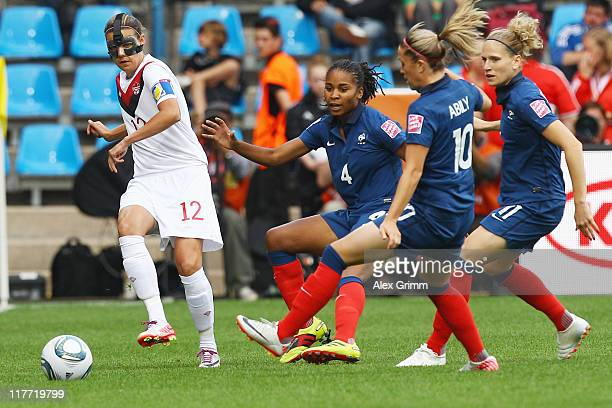 Christine Sinclair of Canada is challenged by Laura Georges Camille Abily and Laure Lepailleur of France during the FIFA Women's World Cup 2011 Group...