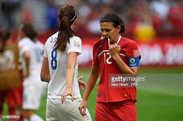 Christine Sinclair of Canada is consoled by Jill Scott of England after the FIFA Women's World Cup 2015 Quarter Final match between England and...