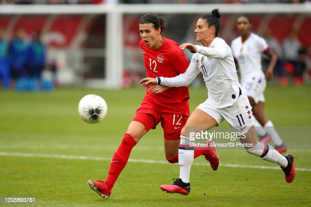 Christine Sinclair of Canada is defended by Ali Krieger of the United States during a game between Canada and United States at Dignity Health Sports...