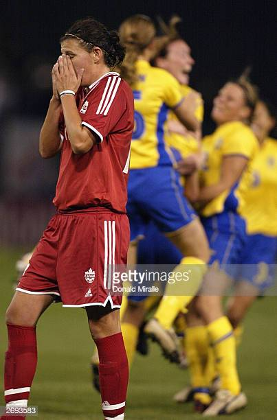Christine Sinclair of Canada reacts as Sweden celebrates Josefine Oeqvist's goal during the semifinals of the FIFA Women's World Cup match on October...