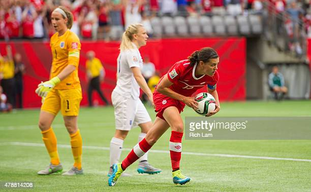 Christine Sinclair of Canada runs the ball back to centre after scorning a goal against goalkeeper Karen Bardsley of England during the FIFA Women's...