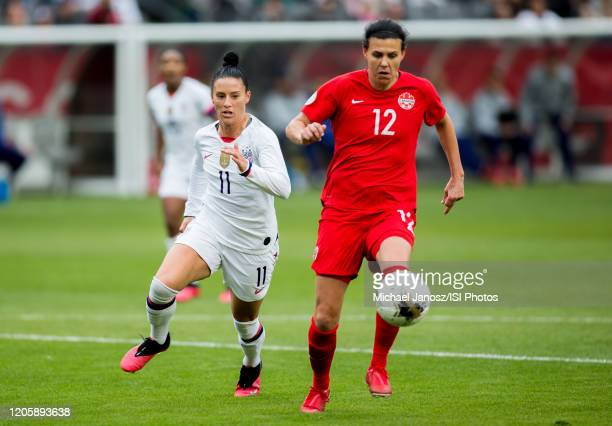 Christine Sinclair of Canada runs with the ball past Ali Krieger during a game between Canada and United States at Dignity Health Sports Park on...