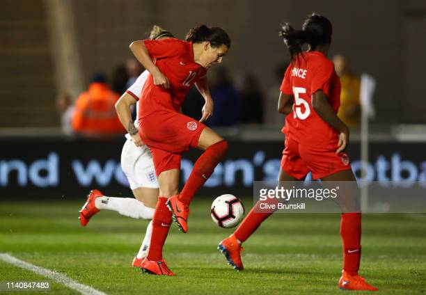 Christine Sinclair of Canada scores her team's first goal during the International Friendly between England Women and Canada Women at The Academy...