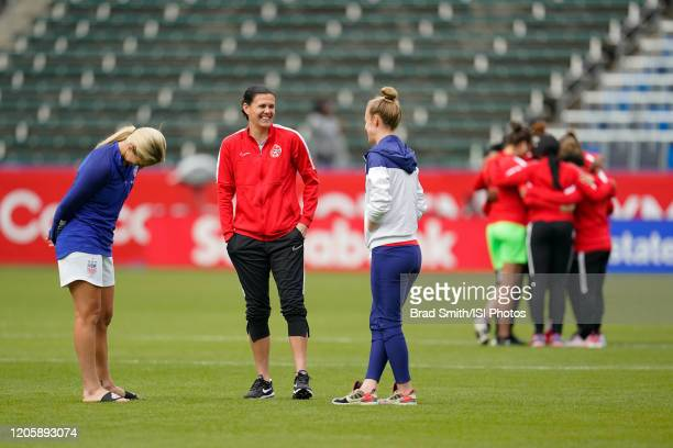 Christine Sinclair of Canada talks with Lindsey Horan and Becky Sauerbrunn of the United States during a game between Canada and United States at...
