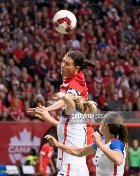 Christine Sinclair of Canada tries to get her head on the ball after outjumping Abby Dahlkemper of the United States during International Friendly...