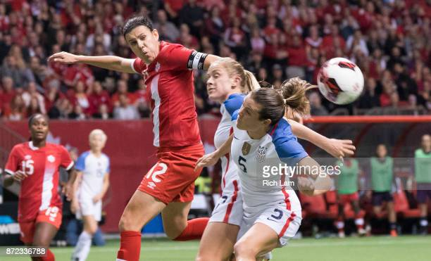 Christine Sinclair of Canada watches the ball sail past Abby Dahlkemper and Kelley O'Hara of the United States during International Friendly soccer...