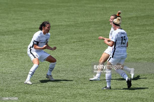 Christine Sinclair of Portland Thorns FC celebrates with her teammates after defeating the North Carolina Courage in the quarterfinal match of the...