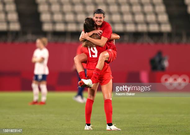 Christine Sinclair of Team Canada jumps on team mate Jordyn Huitema of Team Canada following their side's victory in the Women's Semi-Final match...
