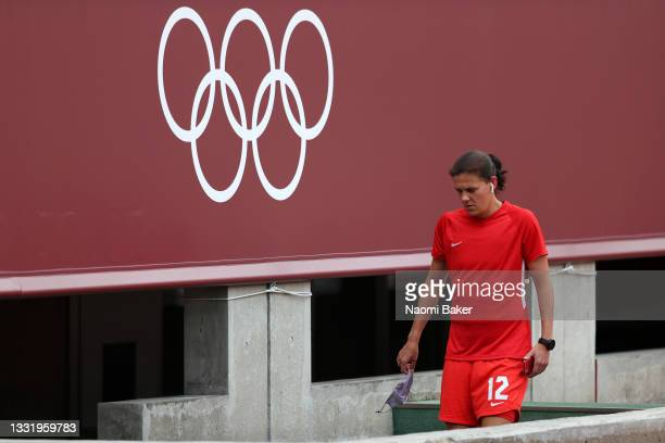 Christine Sinclair of Team Canada walks into the team tunnel after inspecting the pitch ahead of the Women's Football Semifinal match between USA and...