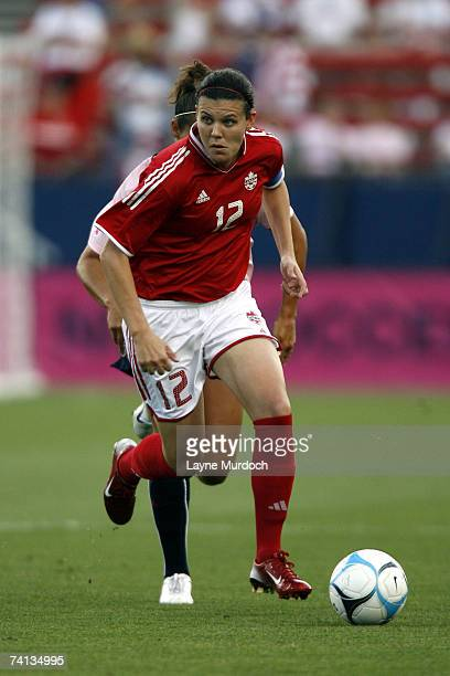 Christine Sinclair of the Canadian Women's Soccer Team dribbles the ball up the field against Carli Lloyd of the U.S. Women's Soccer Team at the...