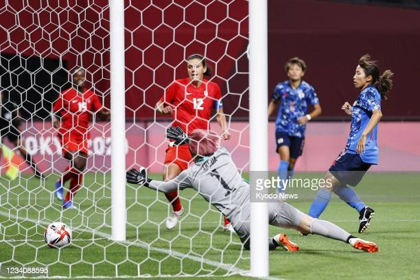 Christine Sinclair scores during the first half of Canada's Group E match of the Tokyo Olympic women's football tournament against Japan on July 21...