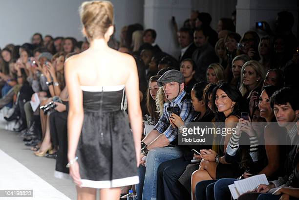 Christine Staub walks the runway as Danielle Staub Rachelle Hruska and Lori Michaels watch on at the Elene Cassis Spring 2011 fashion show during...