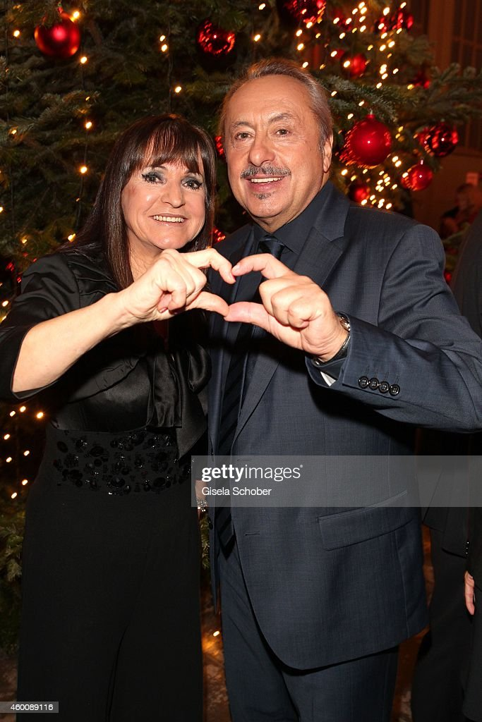 Christine Stumph and Wolfgang Stumph arrive at the Ein Herz fuer Kinder Gala 2014 at Tempelhof Airport on December 6, 2014 in Berlin, Germany.