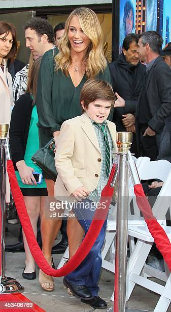 Christine Taylor, Ella Stiller and Quinlin Stiller watch as actor Ben Stiller is honored with a hand and footprint ceremony held at TCL Chinese...