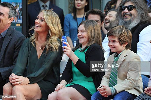 Christine Taylor, Quin Stiller and Ella Stiller pose as Ben Stiller is honored with a hand and footprint ceremony at TCL Chinese Theatre in...