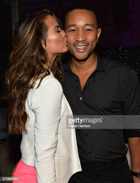 Christine Teigen and John Legend attend Sports Illustrated Swimsuit at Moet Hennessy's The Q at Miami Beach on February 20 2014 in Miami Florida