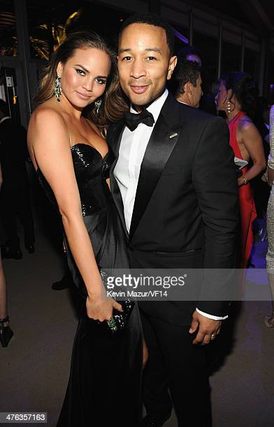Christine Teigen and John Legend attend the 2014 Vanity Fair Oscar Party Hosted By Graydon Carter on March 2, 2014 in West Hollywood, California.