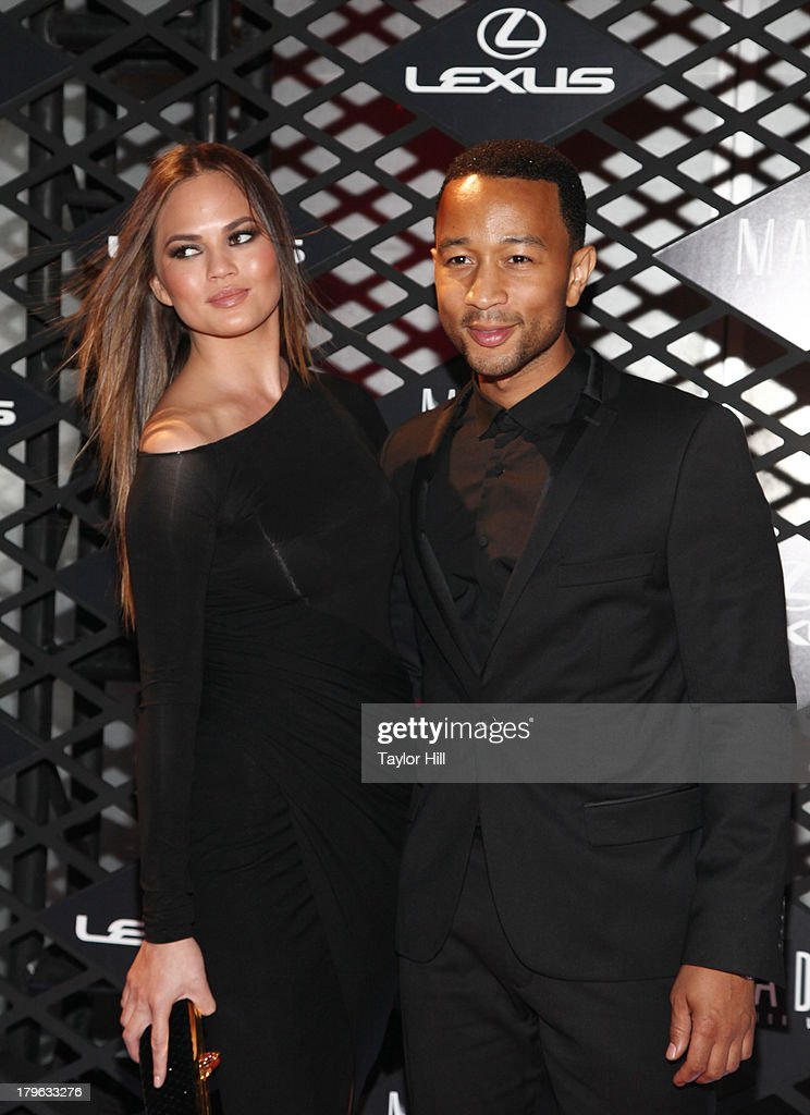Christine Teigen and John Legend attend the Lexus Design Disrupted Fashion Event at SIR Stage 37 on September 5, 2013 in New York City.