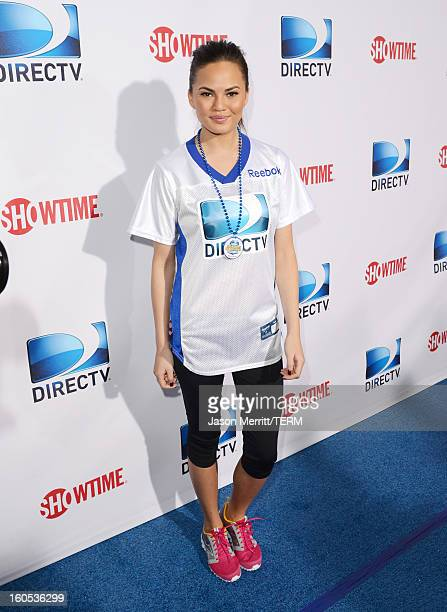 Christine Teigen attends DIRECTV'S Seventh Annual Celebrity Beach Bowl at DTV SuperFan Stadium at Mardi Gras World on February 2 2013 in New Orleans...