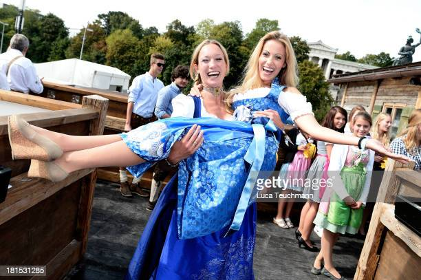 Christine Theiss and Andrea Kaiser attend the Oktoberfest beer festival at the Kaefer Wiesnschaenke tent on September 22 2013 in Munich Germany