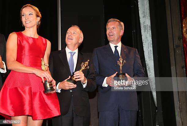 Christine Theiss Richard Blackford Christian Wulff with award during the 'Die Goldene Deutschland' Gala on July 26 2015 at Cuvillies Theater in...