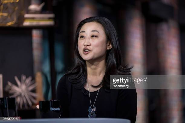 Christine Tsai cofounder and chief executive officer of 500 Startups Management Co watches a presentation during a Bloomberg Technology television...
