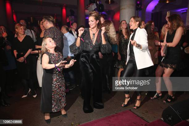 ChrisTine Urspruch Alexandra Kamp and Wolke Hegenbarth dance during the BUNTE BMW Festival Night at Restaurant Gendarmerie during the 69th Berlinale...