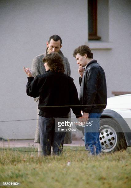 Christine Villemin and her husband JeanMarie talk with their lawyer Maitre Thierry Moser in LepangessurVologne France