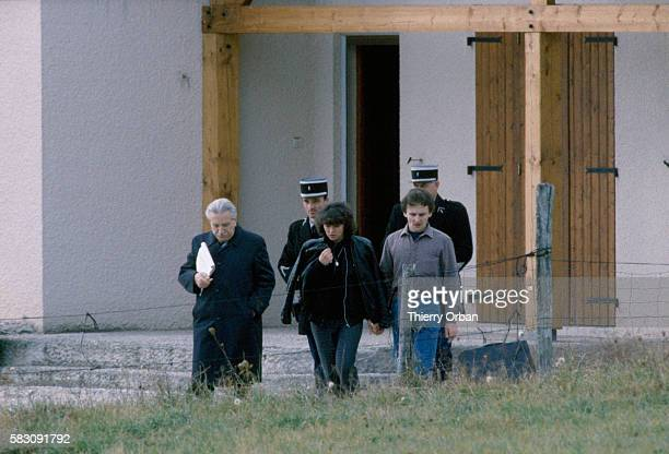 Christine Villemin and her husband JeanMarie talk with their lawyer Maitre HenriRene Garraud in LepangessurVologne France