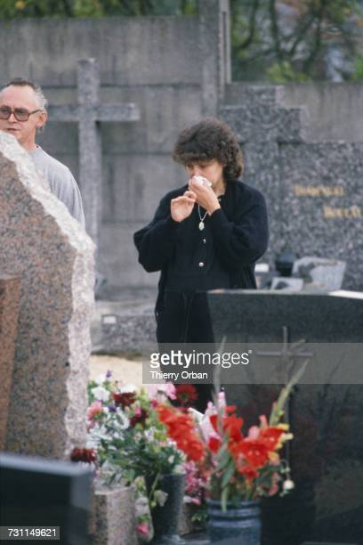 Christine Villemin at the grave of her son Grégory in Lepanges Sur Vologne Vosges France 4th September 1985 Four yearold Grégory Villemin was...