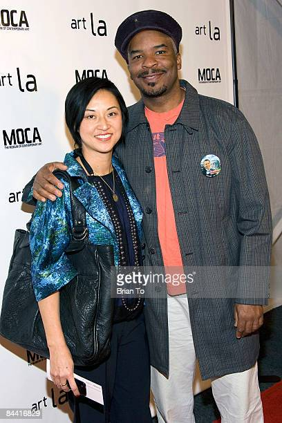 Christine Y Kim and her husband/actor David Alan Grier arrive at ART LA 2009 MOCA Benefit Opening Night Reception at Barker Hangar on January 22 2009...