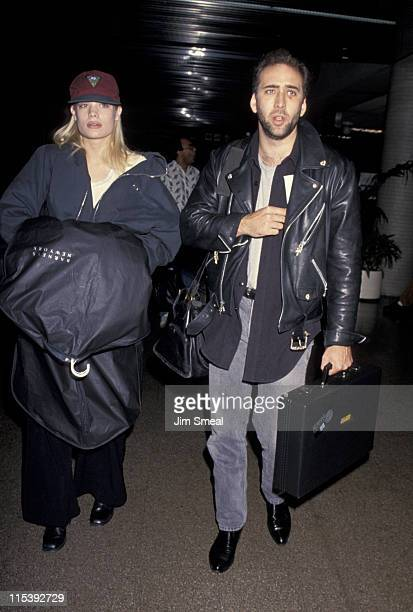 Christine Zang and Nicolas Cage during Christine Zang and Nicolas Cage Sightings at Los Angeles International Airport at Los Angeles International...