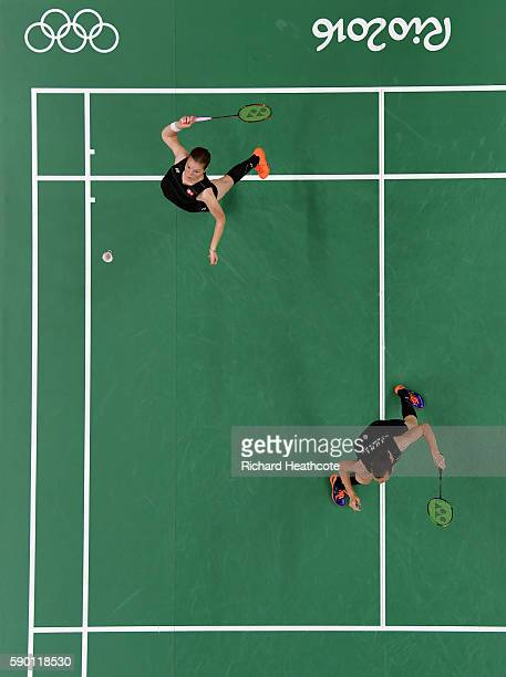 Christinna Pedersen and Kamilla Rytter Juhl of Denamrk in action against Tang Yuanting and Yu Yang of China in the Badminton Women's Doubles...