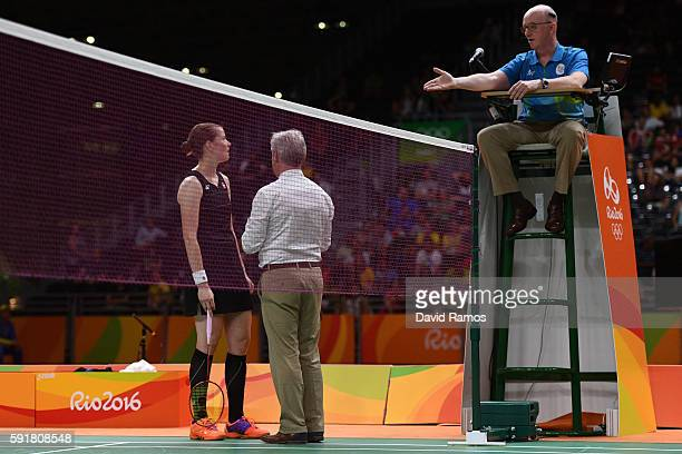Christinna Pedersen of Denmark questions the umpires decision during the Women's Doubles Badminton Gold Medal Match against Misaki Matsutomo and...