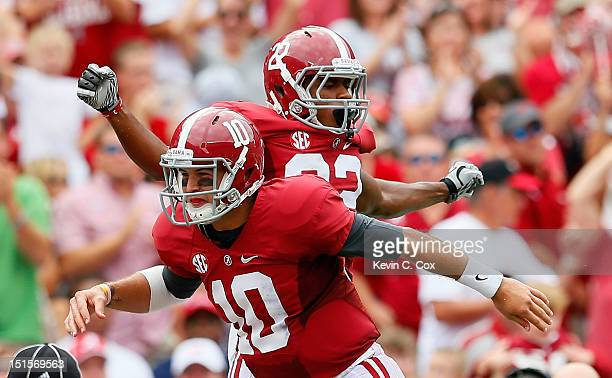 Christion Jones celebrates his touchdown reception from AJ McCarron of the Alabama Crimson Tide against the Western Kentucky Hilltoppers at...