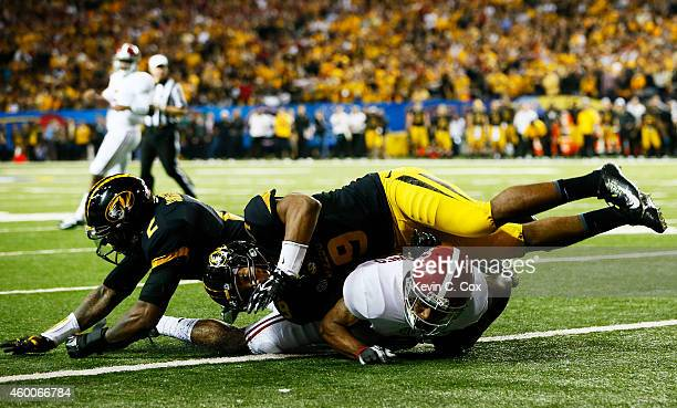 Christion Jones of the Alabama Crimson Tide scores a touchdown against Braylon Webb and Duron Singleton of the Missouri Tigers in the fourth quarter...