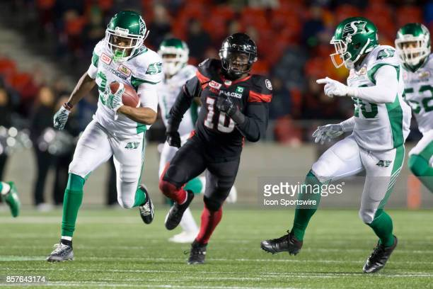 Christion Jones of the Saskatchewan Roughriders runs a punt back for a touchdown against the Ottawa Redblacks The Saskatchewan Rough Riders defeated...
