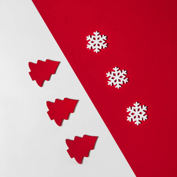 christmas advertising composition for instagram red christmas trees and white snowflakes on background