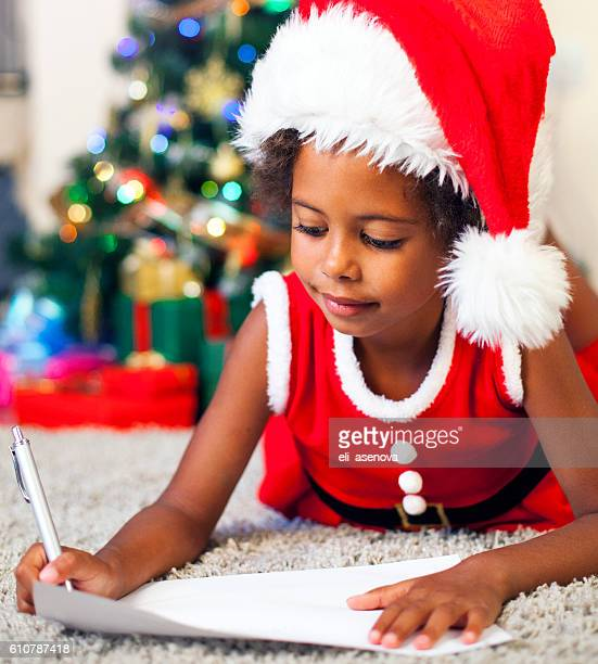 Christmas African American Child Writing a Letter to Santa Claus