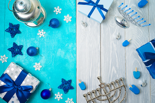 Christmas and Hanukkah celebration concept. Winter holidays background with gift boxes and traditional decorations. 1185082115