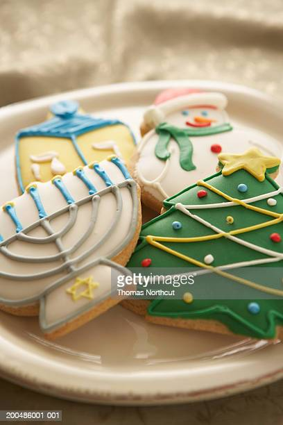 Christmas and Hanukkah cookies on plate, elevated view