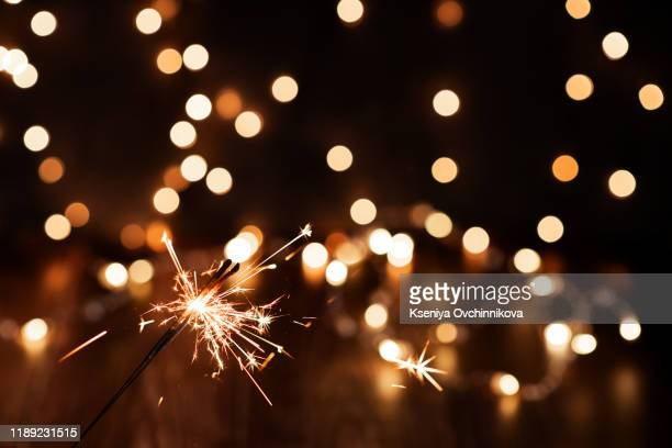 christmas and newyear party sparkler on black - fireworks stock pictures, royalty-free photos & images