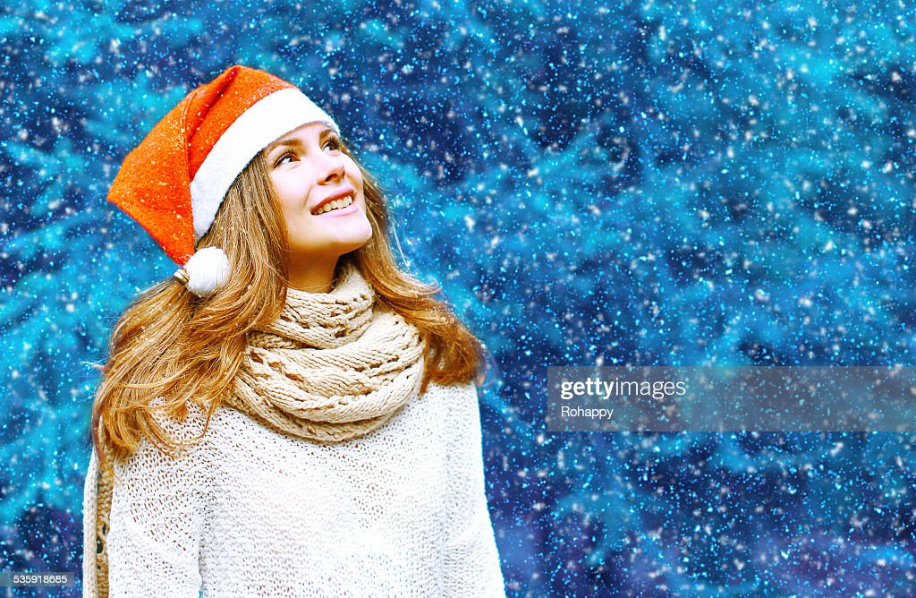 Christmas and people concept - happy woman in red hat : Stock Photo