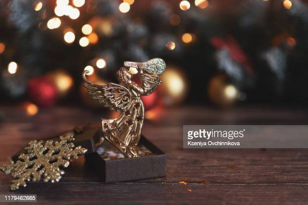 christmas angel with candles over dark background. artwork is created by myself. - angel hot imagens e fotografias de stock